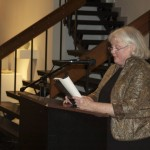 Jesse Carruthers  ||  Judith Shearer reads material to a small crowd in the Clara M. Eagle Art Gallery Thursday night.