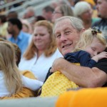Audrey Heitahoff sleeps on her grandfather Joe Barnett's shoulder Saturday during the football game against Tennessee State University.