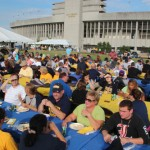 Families eat and enjoy barbecue at the Family Weekend Picnic behind Roy Stewart Stadium.