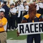 """Dunker holds a """"Racer"""" sign."""