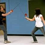 Fencing club members William Huddleston and Alyson Brebes reenact Macbeth in the 2011 Shakespeare Festival.