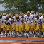 No. 7 Ja-Vonta Trotter leads the Racers on to the field against UT-Martin last Thursday in Martin.