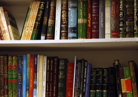 Books written in Arabic adorn the wall at the new Islamic community center in Murray.
