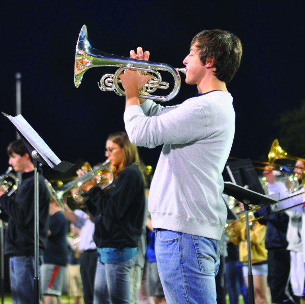 Craig Taylor, senior from Russellville, Ky., practices his mellophone during a Racer Band rehearsal earlier this week. The Racer Band has a record-breaking 310 members this season including 185 returning members. || Kylie Townsend/The News