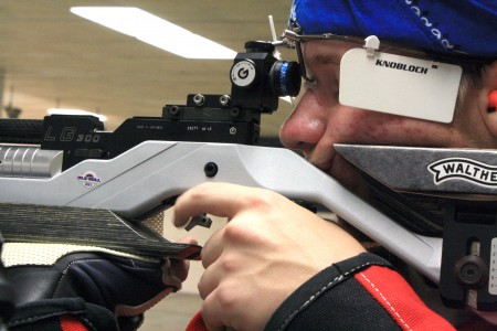 Freshman Ryan Limpus takes aim during a practice session. Limpus posted a career-best in air rifle Saturday.    Austin Ramsey/theNews