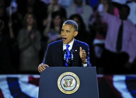 President Barack Obama addresses a large crowd near his home in Chicago Tuesday night after it was announced he had won his second term in office. || Associated Press