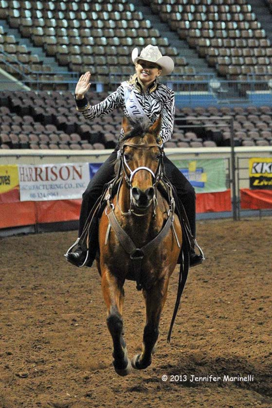 Photo courtesy of Kaitlyne DavisKaitlyne Davis, graduate student from Kevil, Ky., waves to the crowd during the Miss Rodeo USA?pageant. Davis won third runner-up and the horsemanship­ award.