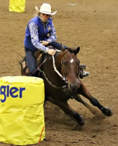 """Taylor Smith, freshman from Benton, Ky., runs the barrels in the William """"Bill"""" Cherry Agricultural Expo Center at the Murray State Rodeo on Oct. 4-6. 