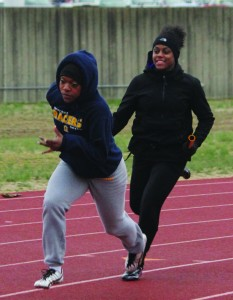 Junior Sharda Bettis and sophomore Natalie Pattin run at Wednesday's practice. The relay team of Bettis, Pattin, senior Alexis Love and sophomore LaShea Shaw finished in fifth in the 4x400 meter relay at the event. || Taylor McStoots/The News