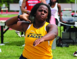 Sophomore Tonia Pratt, from Michigan Center, Mich., draws back to throw a shot put. She was one of four track team members to suffer minor injuries in the bus accident on Jan. 25. || Photo courtesy of Sports Information