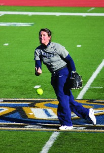 Senior infielder Christian Cox, from Magnolia, Ky., throws a practice pitch. The softball team will compete in the Magic City Classic today through Sunday. || Taylor McStoots/The News