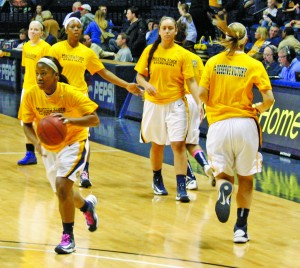 The women's basketball team drill layups before the game. This win gives the Racers a record of 15-7. || Kristen Allen/ The News