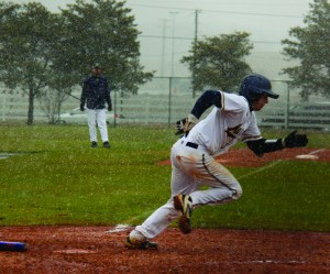 Sophomore Rick Linton runs to first base during Friday's 15-5 loss. Linton recorded one of the 'Breds eight hits of the game.
