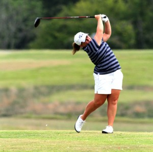 Junior Delaney Howson follows through with her swing during a competition in the fall. She medaled in the Racer Classic on Monday and Tuesday. || Photo courtesy of Sports Information