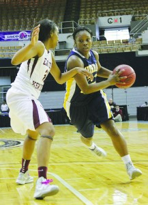 Senior Kyra Watson dribble past an Eastern Kentucky defender at the OVC Tournament game Wednesday night. Though the team started out the first half strong, they could not hold back EKU's strong defense. || Taylor McStoots/The News