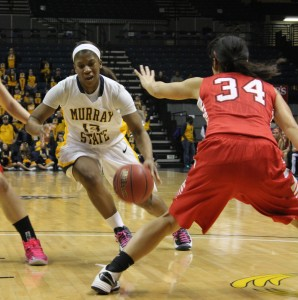 Sophomore guard Keiona Kirby sprints past two Southeast Missouri defenders. After finishing with a 16-3 overall record, the Racers fell out of the OVC?tournament in the first round.    Taylor McStoots/The News