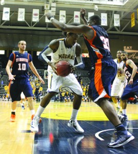 Senior Ed Daniel works his way around UT Martin defender Myles Taylor during Thursday's home game. Daniel scored 19 points and had one assist for the evening, but, despite a strong off­ensive second half, the Racers lost to the Skyhawks by a single point. || Taylor McStoots/The News