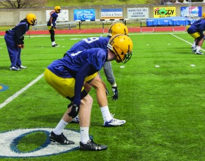Senior Darian Yahyavi, No. 29, and sophomore Tray Carr, No. 17, prepare to begin a drill at Wednesday's practice. This is the second spring practice of the year. The team is hoping to strengthen its defense by trying new strategies and switching positions.    Taylor McStoots/The News