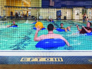 Students participate in an inner tube water polo match. Because the new sport needs the pool at the Susan E. Bauerfiend Wellness Center, the  season lasted four weeks with only one game per week.|| Beamer Barron/The News