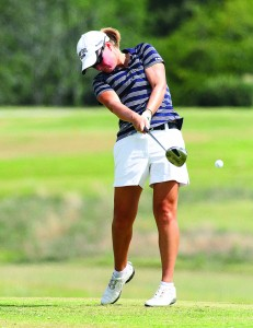 Freshman Abbi Stamper follows through with her swing. The women were coming off of first and second place finishing at their previous two matches, but struggled Monday and Tuesday due to weather. || Photo courtesy of Sports Information