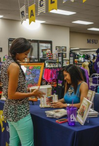Kelsey Young had her book signed Tuesday by author Galileo Simmons. Simmons had finished a book series her mother had been working on before she passed away. || Kristen Allen