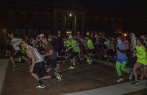 Runners take their places as the begin the 5K Glow Run Friday, April 19. || Taylor McStoots