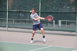 Junior Adam Taylor readies himself to hit the ball to his opponent at a recent home match. The team is now 0-14 on the season after losing to Austin Peay Tuesday and UK Wednesday. || Photo courtesy of Sports Information