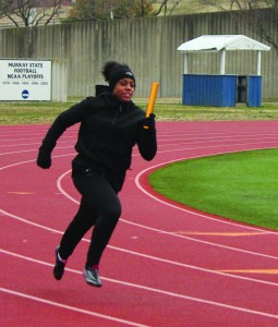 Freshman Hannah McAllister runs toward her teammate to handoff the baton at a recent practice. The Racers won 12 events in Bowling Green last week.    Taylor McStoots/The News