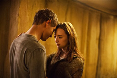 "Melanie Stryder, played by Saoirse Ronan, and Jake Abel, played by Max Irons, share a rare romantic moment in director Andrew Niccol's ""The Host."" 