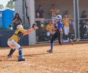 Senior catcher Ellyn Troup prepares to tag out a runner during the Racers loss Wednesday. Kate Russell/The News