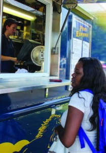 A Murray State student waits outside the mobile food truck, The Pony Express, for her lunch to be prepared.   Photo by Kate Russell / The News