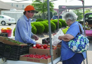 Lori Allen/The News Maxine Pool of Murray purchases fresh vegetables from Wurth Farms.