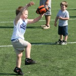 The children got a chance to punt and kick early in the day.