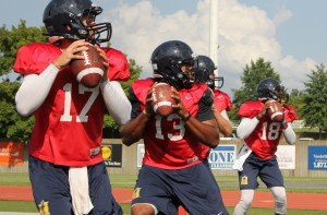 Sophomore Ole Miss transfer Maikhail Miller, no. 13, won the race for the starting quarterback earlier this week. He will get his first chance to lead the team when they travel to Missouri Aug. 30.  // Photo by Kate Russell / The News