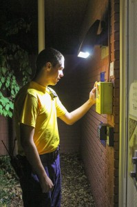 Kate Russell/The News Aaron Burkeen, a sophomore from Murray, checks one of the many call boxes on campus.