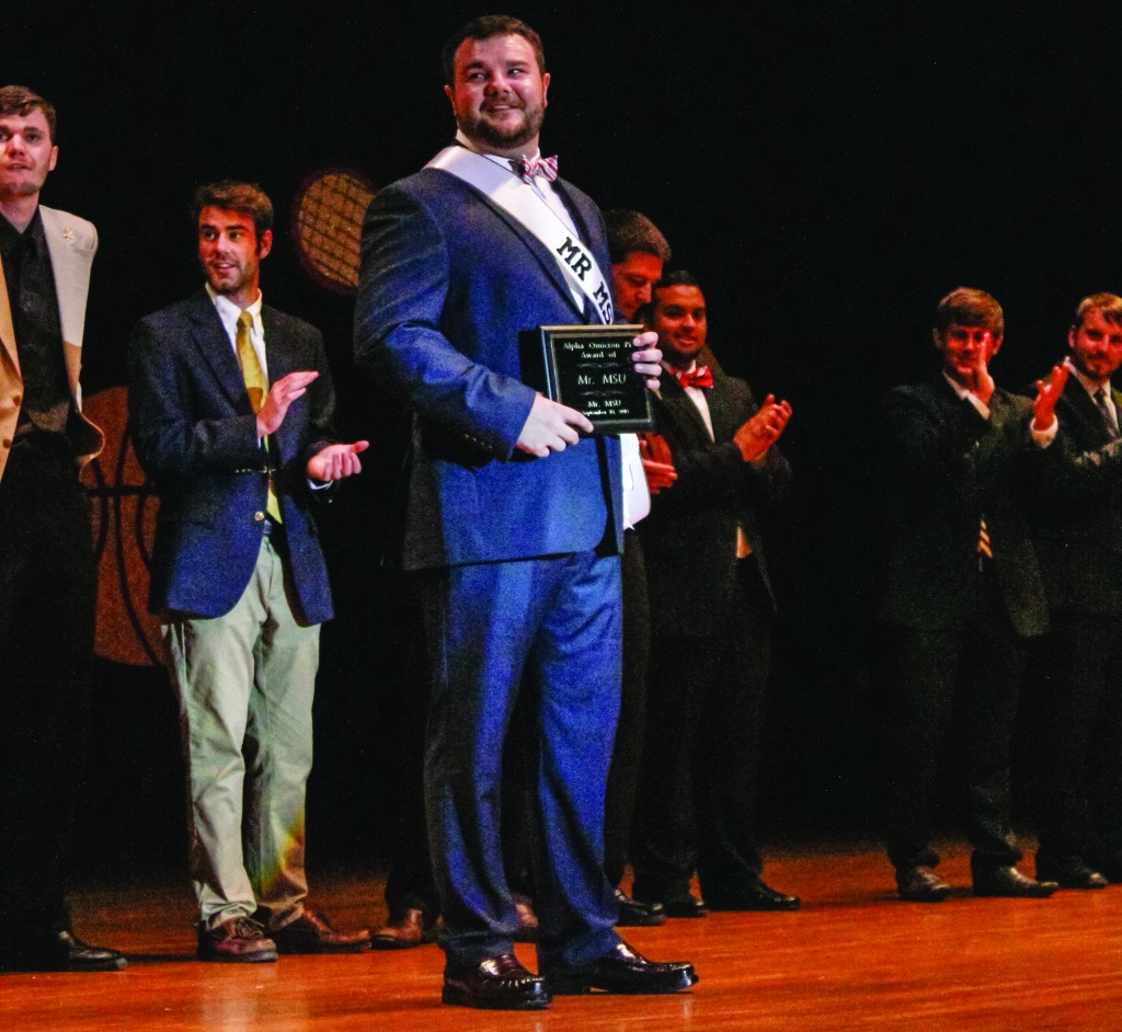 Taylor McStoots/The News Tyler Glosson accepts his award for Mr. MSU 2013.