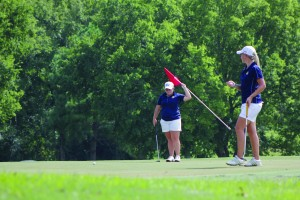 Lori Allen/The News Senior Delaney Howson (left) will serve as a leader for the young women's golf team. Howson has led the team in scoring for three seasons.
