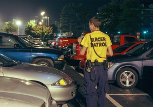 File Photo / A member of Racer Patrol walks through campus to monitor activity at night.