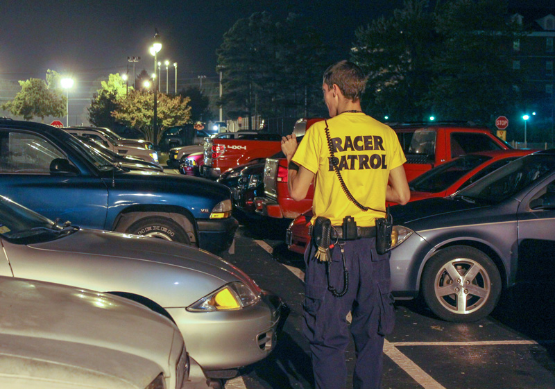 File Photo A member of Racer Patrol walks through campus to monitor activity at night.