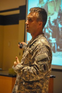 Torrey Perkins /The News  Arnett lectures to students in Jones Hall's large auditorium about combat medicine and his career.