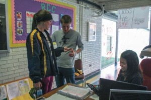 Kate Russell // The News / Grecia White, junior from Fort Rucker, Ala., checks in students at Springer Residential College.