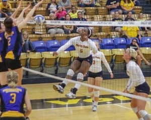 Lori Allen // The News / Freshman Kamille Jones (No. 5), from Fort Worth, Texas, successfully spikes for the Racers.