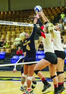 Lori Allen/The News Sophomore setter Sam Bedard goes up for a block against two SEMO players.