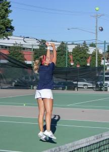 Lori Allen // The News  Senior Carla Suga returns a volley in practice.
