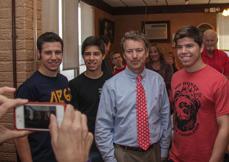 Lori Allen // The News / Sen. Paul poses for a photo with (L-R) Leeman, Seth and Lowell Stevens. Leeman(freshman) and Lowell(senior) are Murray State students and Seth is a high school junior.
