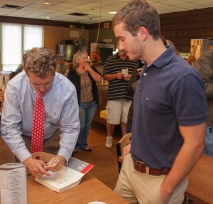Lori Allen // The News / Drew Brown, a Tenn. resident and Paul supporter, gets his copy of the senator's book signed.