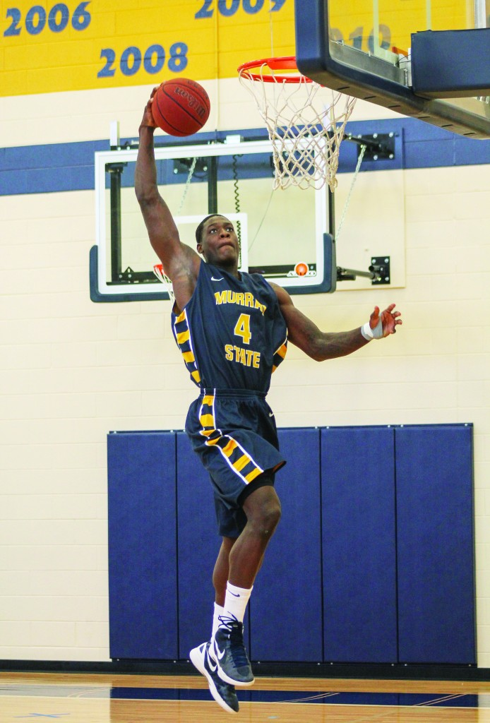 Jenny Rohl/Contributing photographer Junior forward Jarvis Williams dunks the ball in a practice in the Racers' new practice gym.