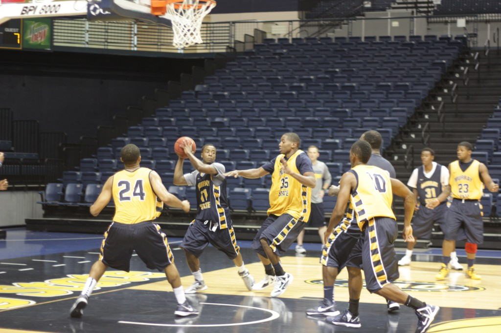 Lori Allen/The News Sophomore guard C.J. Ford looks for an outlet during preseason workouts last week.