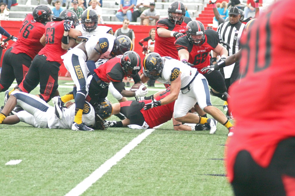 Ryan?Richardson/The News Several Racers attempt to stop the Redhawks from scoring one of their five touchdowns Saturday in the loss to SEMO.