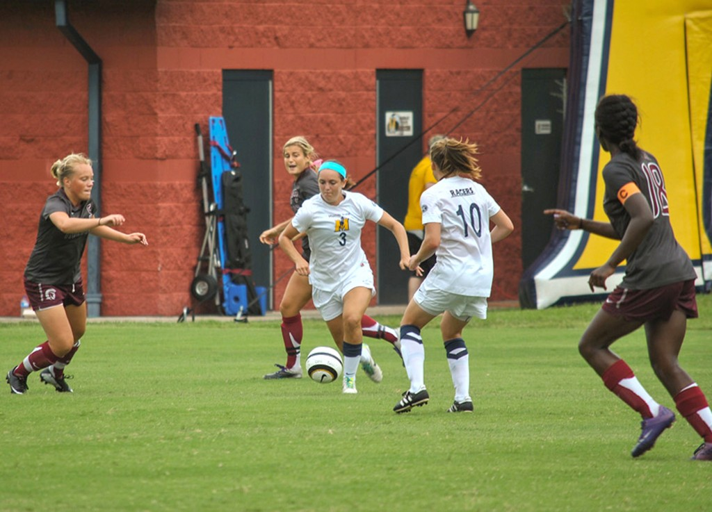 File photo Junior midfielder (3) Julie Mooney carries the ball upfield as junior defender Bronagh Kerens (10) stands open for a pass during a game against University of Arkansas at Little Rock this season.